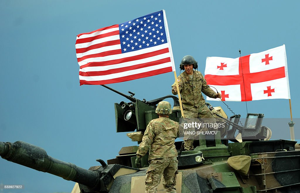 US servicemen stand atop a M1A2 Abrams tank during the Noble Partner 2016 joint military exercise at the Vaziani training area outside Tbilisi on May 24, 2016. Some 500 Georgian, 650 US and 150 British troops are taking part in the drills, billed as the largest ever to be held in the Caucasus nation, which fought a brief war with Russia in 2008. / AFP / Vano Shlamov