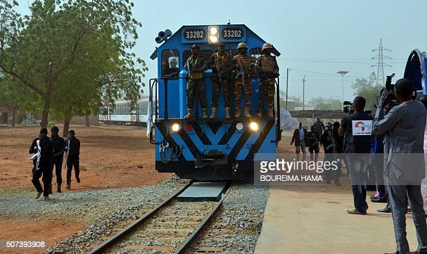 Servicemen stand guard as a train arrives to the railway station in Niamey on January 29 during the inauguration of a section of a railway line of...