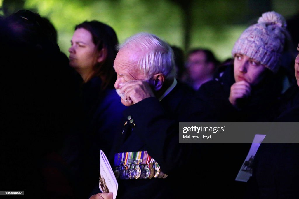 A servicemen wipes his eye during a dawn remembrance service at the Wellington Arch on ANZAC Day at Hyde Park on April 25, 2014 in London, England. It is the 99th anniversary of the Galipoli landings in which tens of thousands of servicemen died.