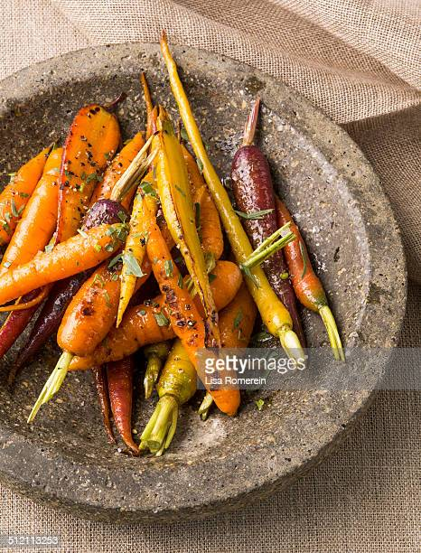 Serviing bowl of maple-glazed carrots