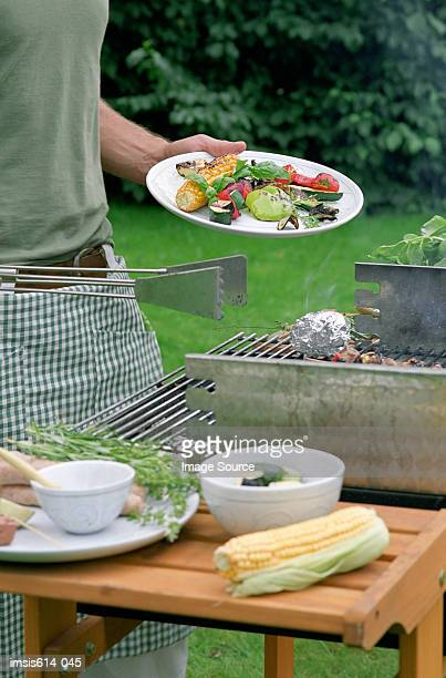 Serving a barbeque meal.