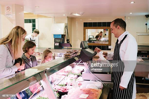 Serving a customer, traditional British Butcher's shop