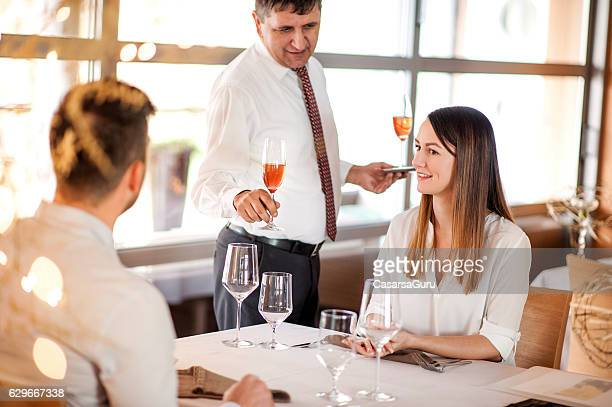 Serving a Glass of Red Sparkling Wine in a Restaurant