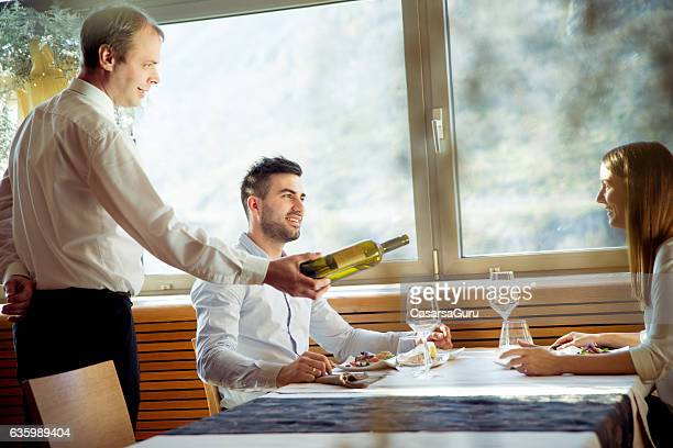 Serving a Glass of White Wine in a Restaurant