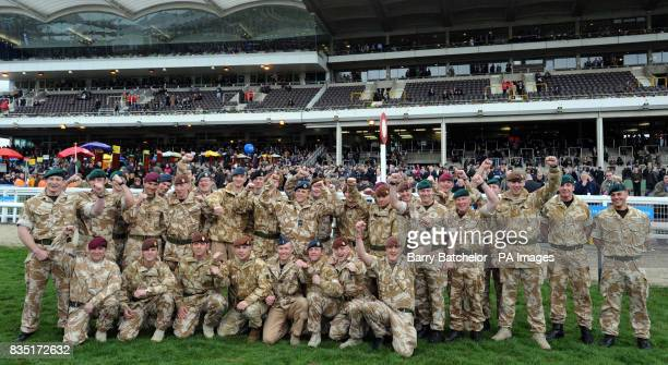 Serving personnel who have recently returned from serving overseas line up in support of the British Forces Foundation by the winning post at...