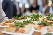 Serving pizza slices