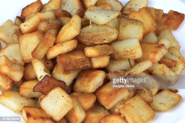 Serving plate of southern potato homefries (Solanum tuberosum)