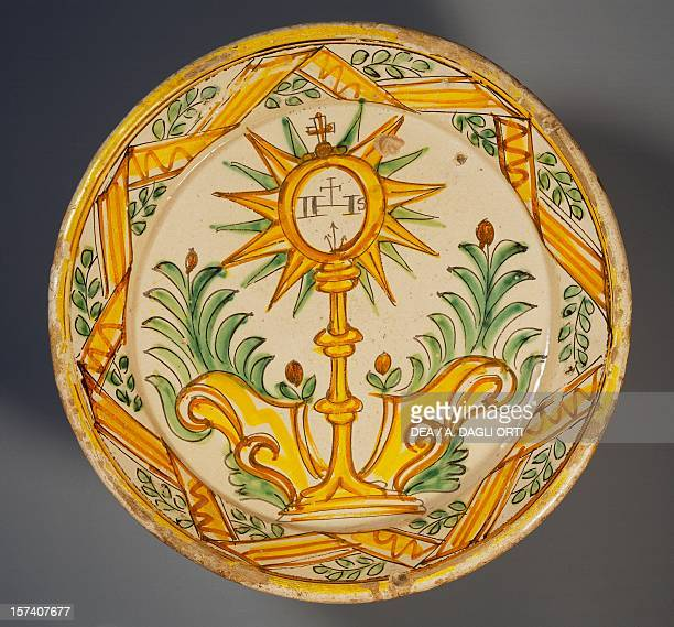Serving platter decorated with a monstrance maiolica Ariano Irpino manufacture Campania Italy 19th century Ariano Irpino Museo Civico Palazzo Forte