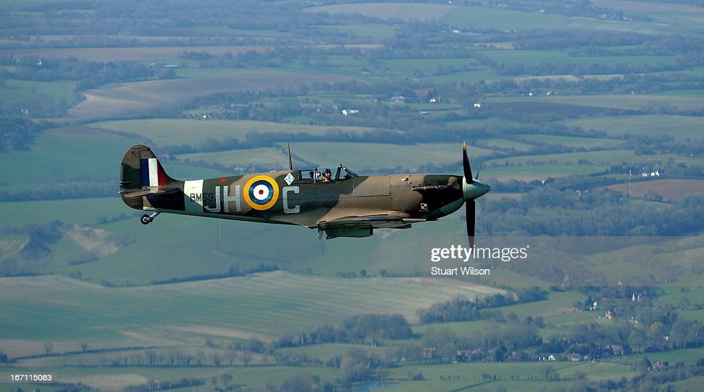 Serving RAF pilot Charlie Brown flies a Spitfire BM597, a combat veteran aircraft of World War Two, over Kent as seen from a helicopter during the 'Fly With A Spitfire' Event run by 'Action Stations' from Lydd Airport on April 20, 2013 in flight, over Kent. Fare paying passengers can fly next to the spitfire on selected dates throughout the year. The aircraft is flown by Charlie Brown, a serving member of the RAF.