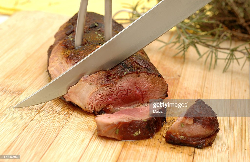 Serving the magret. : Stock Photo
