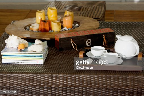 Serving tray and candles on a table : Stock Photo