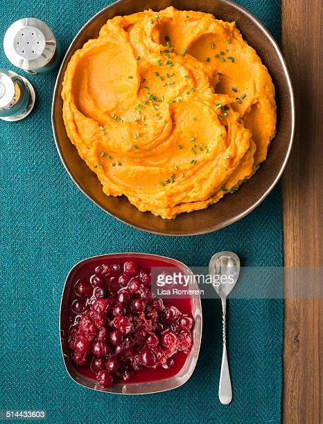 Servings of mashed sweet potatoes & cranberries