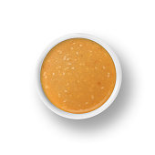 dressing sauce condiment in small cup dish on white background