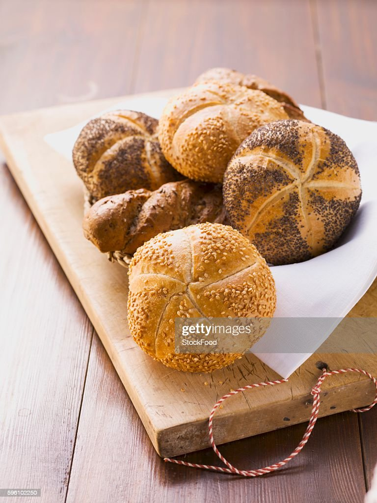 Sesame rolls, poppy seed rolls and seeded baguettes in a bread basket