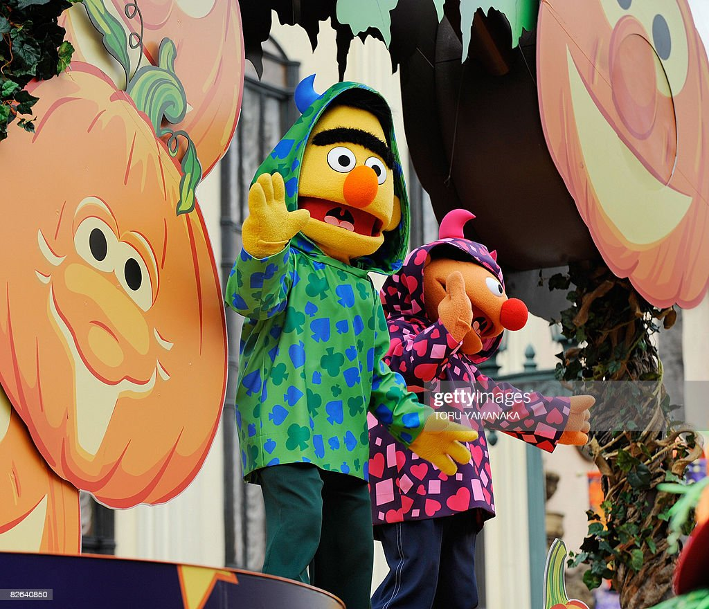 Sesame Street characters Bert and Ernie wave to the audience from a special float during the press preview of the Halloween Character Parade at the...