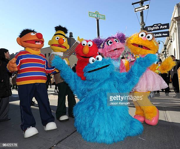 Sesame Street characters Ernie Bert Elmo Cookie Monster Abby Cadabby and Zoe attend the temporary street renaming to celebrate the 30th anniversary...