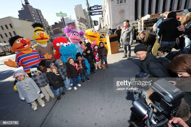 Sesame Street characters Ernie Bert Elmo Cookie Monster Abby Cadabby Zoe and children from the Garden of Dreams Foundation attend the temporary...