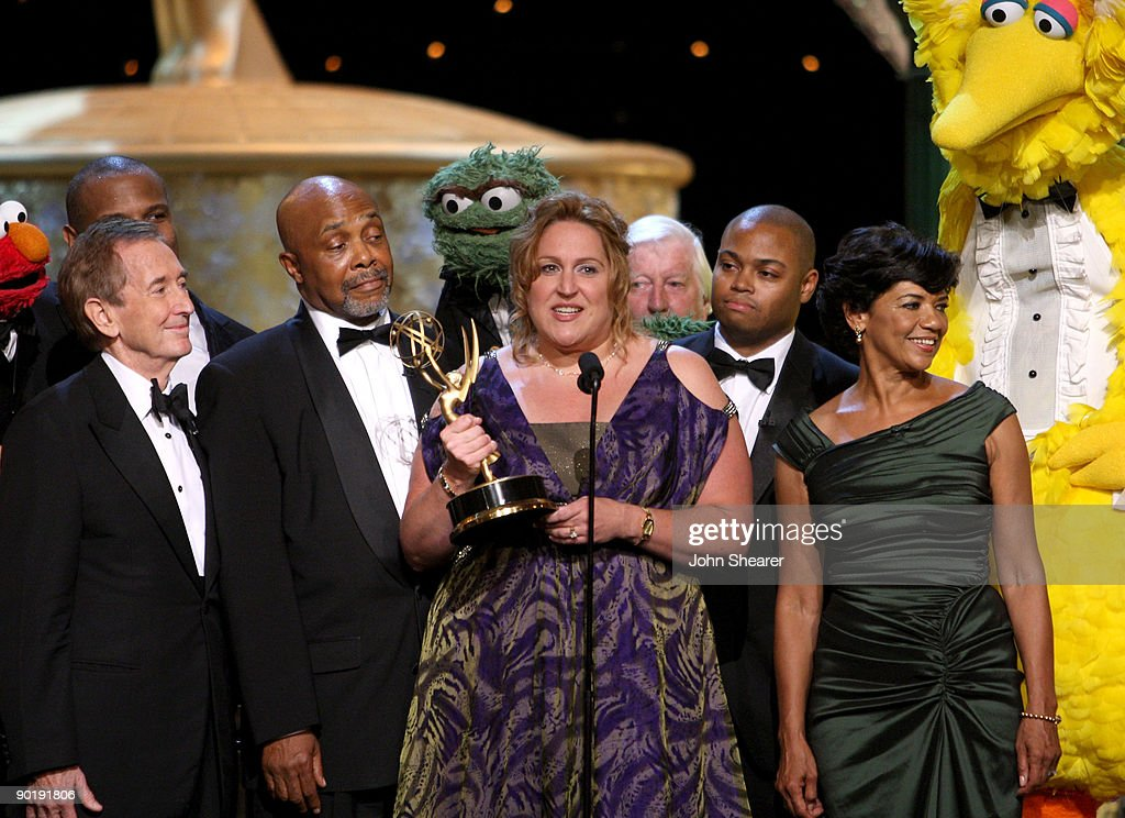 'Sesame Street' executive producer Carol-Lynn Parente (C) accepts the Emmy Lifetime Achievement Award during the 36th Annual Daytime Emmy Awards at The Orpheum Theatre on August 30, 2009 in Los Angeles, California.