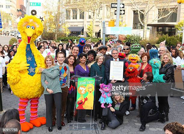 Sesame Street founder and TV producer Joan Ganz Cooney holds the New York City proclamation 'Sesame Street Day' along with the cast and crew of...