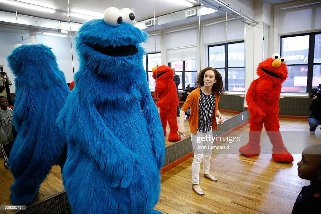 Sesame Street Live Performance Director Molly Jackson, Elmo, Cookie Monster and children from the Garden of Dreams Foundation attend Sesame Street Live Dance Class at Ripley Greer Studios on February 10, 2016 in New York City.