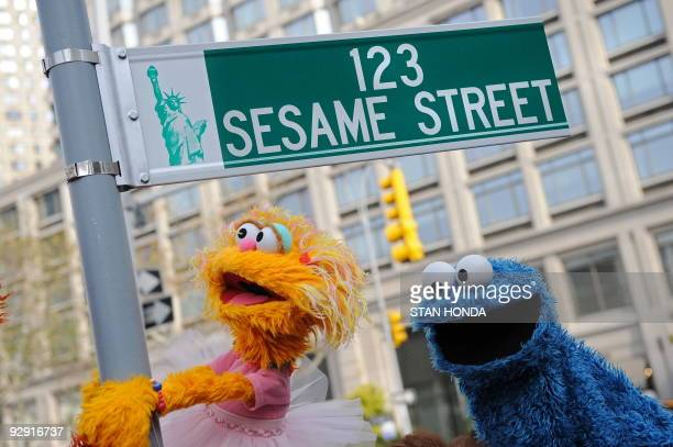 Sesame Street puppet charactors Zoe and Cookie Monster pose next to temporarty street sign November 9 2009 at West 64th Street and Broadway in New...