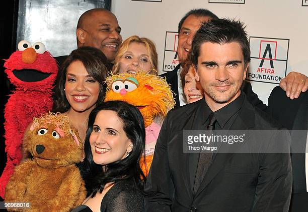 Sesame Street's Desiree Casado Kevin Clash Stephanie D'Abruzzo Alison Bartlett O'Reilly and musician Juanes attend the 2010 AFTRA AMEE Awards at The...