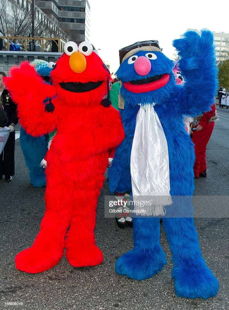 Sesame Street's Elmo and Grover attend the 93rd annual Dunkin' Donuts Thanksgiving Day Parade on November 22, 2012 in Philadelphia, Pennsylvania.