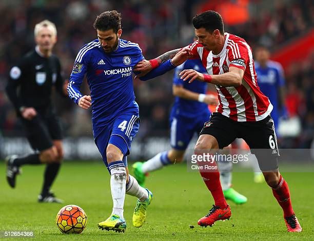 Sesc Fabregas of Chelsea and Jose Fonte of Southampton compete for the ball during the Barclays Premier League match between Southampton and Chelsea...