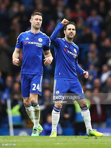 Sesc Fabregas of Chelsea celebrates scoring his team's first goal with his team mates during the Barclays Premier League match between Chelsea and...