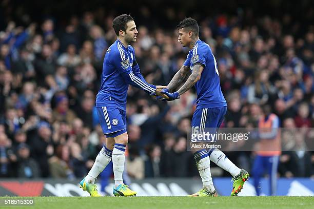 Sesc Fabregas of Chelsea celebrates scoring his team's first goal with his team mate Kenedy during the Barclays Premier League match between Chelsea...