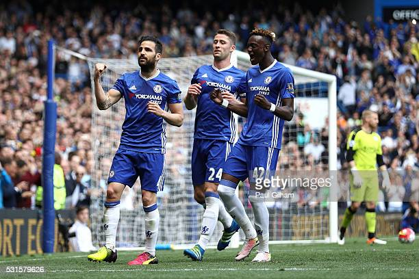 Sesc Fabregas of Chelsea celebrates scoring his team's first goal with his team mates Gary Cahill and Tammy Abraham during the Barclays Premier...