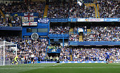 Sesc Fabregas of Chelsea converts the penalty to score his team's first goal during the Barclays Premier League match between Chelsea and Leicester...