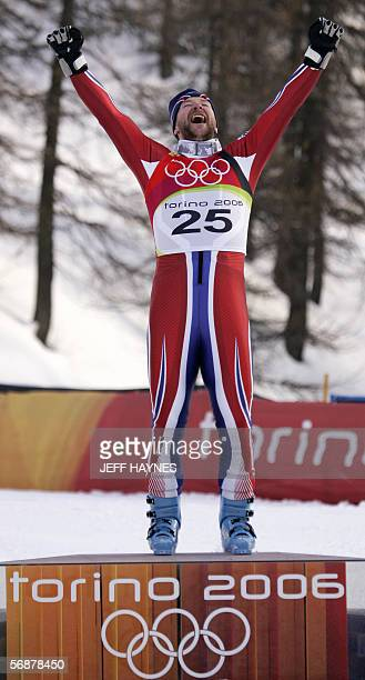 Kjetil Andre Aamodt from Norway celebrates on the podium 18 February 2006 following the Men's SuperG in Sestriere Borgota Italy Aamodt who stopped...