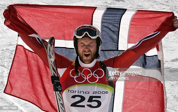 Kjetil Andre Aamodt from Norway celebrates with his national colors 18 February 2006 following the Men's SuperG second run in Sestriere Borgota Italy...