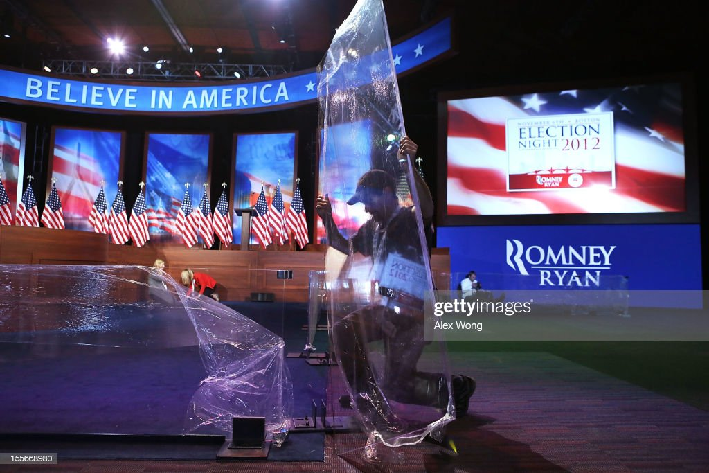 Set builder Kevin Simard of Mystic Scenic Studios Inc. assembles a plexiglass barricade at the Boston Convention and Exhibition Center for Mitt Romney Campaign's election night event November 6, 2012 in Boston, Massachusetts. As Americans go to vote, President Barack Obama and Republican nominee former Massachusetts Gov. Mitt Romney remain in a virtual tie in the national polls.