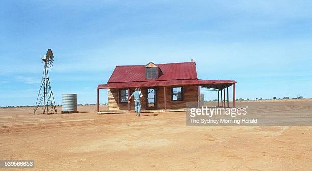 Set constructor Merv Tucker in front of the pub that has been used in at least twenty XXXX beer ads forty minutes west of Broken Hill NSW on 22 April...