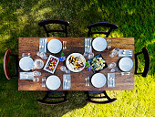 Set dinner table outside on grass lawn