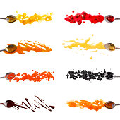 teaspoons dipped in the sauces.splashes and paths of toppings. orange jam, raspberry jam, maple syrup, honey, red and black caviar, chocolate, apricot jam. A collection of sauces for pancakes, waffles