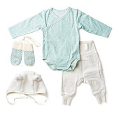 Set of blue baby clothes on white background, top view