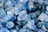 Set of uncut, rough and raw blue sapphires.