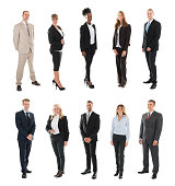 Set Of Businesspeople Standing Against White Background