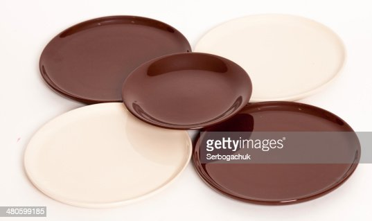 set of ceramic plates in beige and brown : Stock Photo