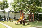 Set of children playground under big tree in the park.