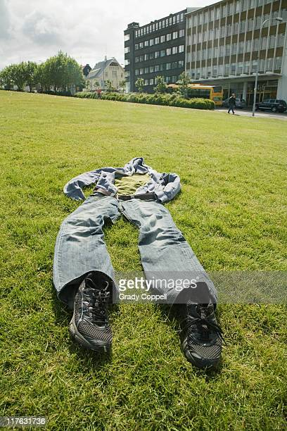 Set of clothes laid on grass in city
