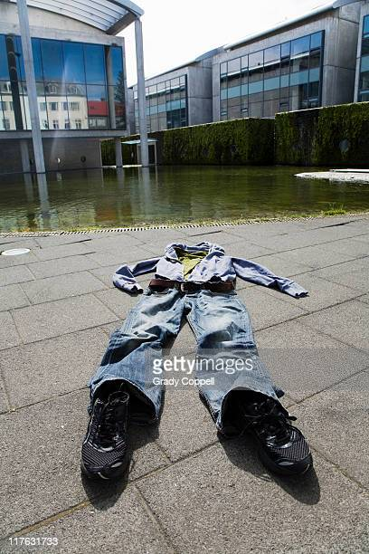 Set of clothes on pavement in city