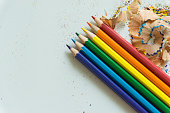 A Set of crayons and debris from the sharpening on white background
