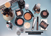 Set of decorative cosmetic. Powder, concealer, eye shadow brush, blush, foundation.