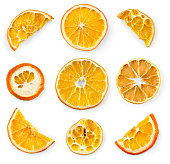 Set of dried slices and half a slice of orange and lemon, isolated on white background