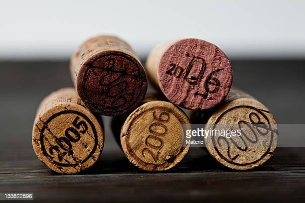 Set of five wine corks with various years engraved