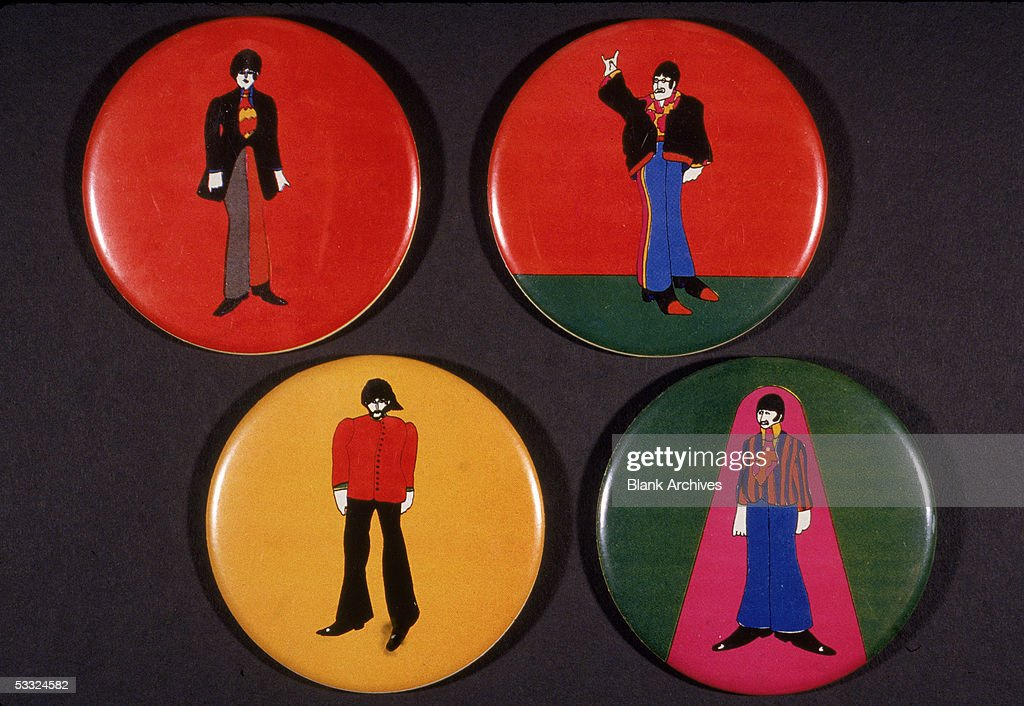 Set of four pin-backed buttons to promote the animated movie 'Yellow Submarine,' 1968. The buttons depicted cartoon renditions of the member of the Brtish pop group, the Beatles, who star in the film; clockwork from upper left, Paul McCartney, John Lennon (1940 - 1980), Ringo Starr, and George Harrison (1943 - 2001).